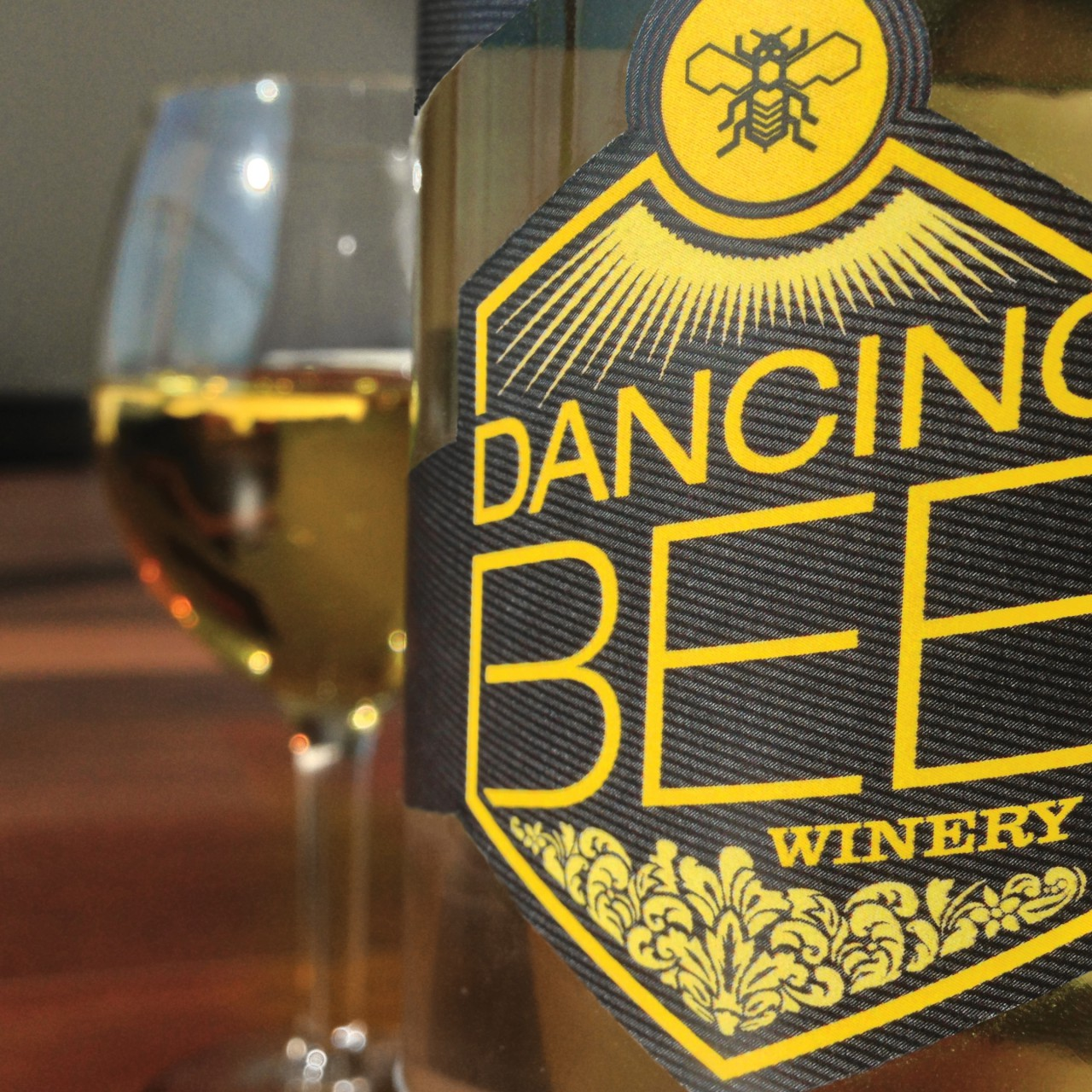 Image of Dancing Bee Winery logo on bottle label